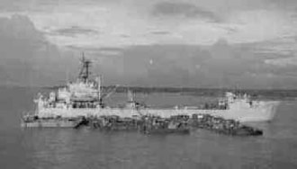 USS Tom Green County (LST-1159) - Tom Green County (LST-1159) at anchor in the Mekong River, circa 1968.