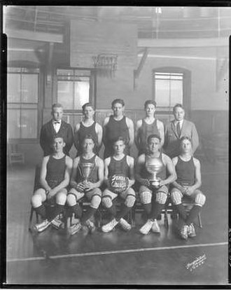 Dennis K. Stanley - 1923-24 Hillsborough High basketball team. Stanley is seated second from left, holding the cup.