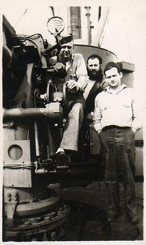 """USS Anacapa (AG-49) - Crew and 4"""" gun mount. These guns were disguised as crates when not in use."""
