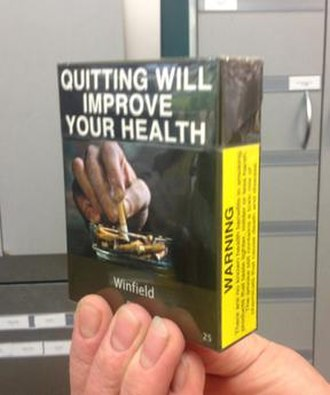 Cigarette pack - Plain cigarette packaging, as required in Australia since 2012: the pack has an olive drab colour, with the brand name printed in a standard font and size – no logo, other colour or branding allowed.