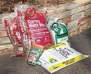 Plastic bags of gardening supplies fresh produ...