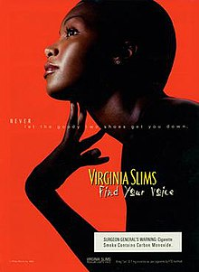 "Ad showing a young, carefully made-up, dark-skinned model leaning forwards, looking upwards and delicately touching her extended throat; she is nearly exactly in profile, in silhouette on a bright red ground, with the light catching only her face, throat, fingers, and a single clear stone in her earlobe. Her hair seems very closely cropped. A subtle white overlaid text reads ""NEVER let the goody two shoes get you down"" and, in a much larger shadowed yellow hand-written-looking font, ""Find your voice"""