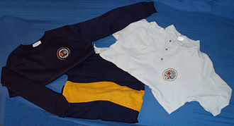 Gosforth Academy - A selection of the school's uniform; The navy blue sweatshirt and white polo shirt with a yellow ring around the then high school logo and the outdoor jersey