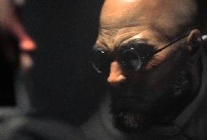 Hugo Strange - Hugo Strange in a cinematic trailer for Batman: Arkham City