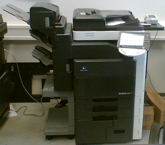 Konica Minolta - A Konica Minolta bizhub C451 MFP with an attached finisher.