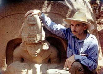 Matthew Stirling - Matthew Stirling posing with the primary figure from Altar 5, La Venta.  This is a still from the Smithsonian Institution's Exploring Hidden Mexico (1943).