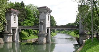 sluice gate and a triumphal arch on the Ljubljanica River in Ljubljana