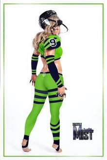 "Rear view of woman wearing 2017 Legends Football League ""full pants"" uniform, consisting of green skin-tight leggings, bra, shoulder pads, forearm sleeves, and hockey-style helmet."