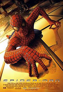 Spider-Man in his famous suit crawling over a building and looking towards the viewer. Below of him is New York City, the film's title, credits and release date.