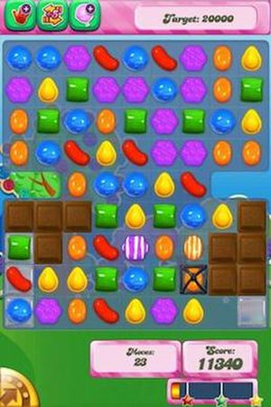 Candy Crush Saga - Candy Crush Saga gameplay on iOS, with candy, striped candies, jelly, licorice, and chocolate