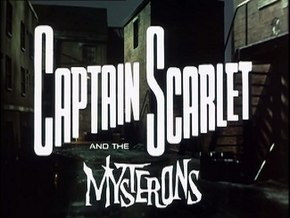 "In bold, white letters, the words ""Captain Scarlet"" are superimposed on the backdrop of a derelict, night-time alleyway. Added at the bottom of the picture are more words, ""and the Mysterons"", the last of which is in white, spiky lettering. The full title is thus revealed to be ""Captain Scarlet and the Mysterons""."