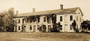 """Ceresco, Wisconsin - The """"edifice"""" of the Wisconsin Phalanx for collective dwelling was this """"long house"""" more than 200 feet in length. As of 2014 the building was still in existence in its original location, used as an apartment building."""