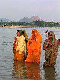 Women performing Chhat Puja in the Falgu River in Gaya.