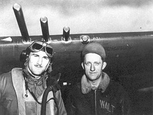 Bill Guckeyson - Captain John W. Guckeyson (left) and his crew chief pose in front of his P-47 fighter.