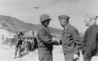Omar Bradley - Army Chief of Staff General George Marshall (center) and Army Air Forces Commander General Henry H. Arnold confer with Bradley on the beach at Normandy in 1944.