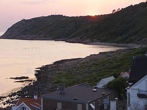 Mölle - Looking west into the Kullaberg along the rocky shore from the rooftops of Mölle