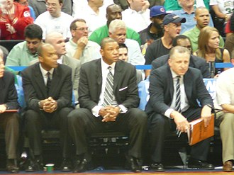 Doc Rivers - Rivers (center) sits on the sidelines with assistant coaches Tom Thibodeau (right) and Armond Hill (left) in Game 4 of the 2008 NBA Playoffs against the Atlanta Hawks.