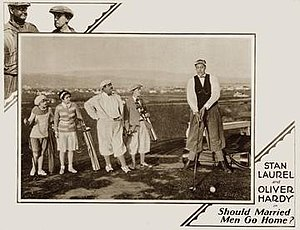 """Should Married Men Go Home? - Very Tall Golfer and how. John Aasen may have been as tall as 8'9"""" though """"just"""" 8-feet might have been more accurate. Marion and Richard are at left. 1928 Lobby card."""