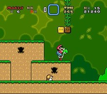 This screenshot shows Mario riding Yoshi during the first level of the game. The scenery shows a jungle environment with floating blocks scattered in the air. The interface displayed around the corners shows the number of lives that the player has, the Dragon Coins collected, the player's stored power-up, the level's remaining time, the player's number of coins, and the total score of the player.