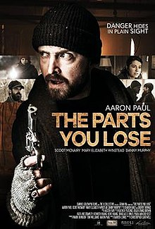 Aaron Paul in character with heavy clothing and a gun, framed by four screenshots of other characters in the film.