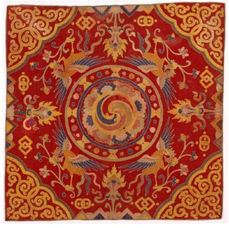 "Bhutan - A thrikhep (throne cover) from the 19th century. Throne covers were placed atop the temple cushions used by high lamas. The central circular swirling quadrune is the gankyil in its mode as the ""Four Joys""."