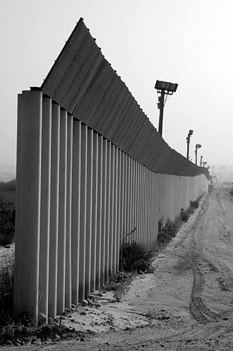 Tortilla Wall - Parts of the wall are built with concrete pillars (bollards) to prevent vehicle crash-throughs