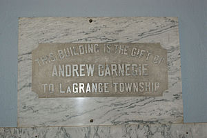Cass District Library - This is the marble plaque which has been placed on the right as patrons enter the library, to highlight that the building was a gift from Andrew Carnegie to the township.