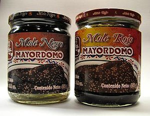 Mole sauce - Jars of commercially available mole negro and mole rojo, as sold in Oaxaca, Mexico