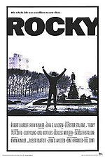 The British poster for the movie Rocky showing the Rocky character at the top of the museum's entrance steps, also known as the Rocky Steps