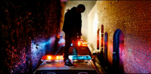 All of the Lights - West on a police car in the music video.