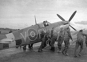 History of transport - Pilots of 611 ''West Lancashire'' Squadron lend a hand pushing an early Spitfire Mark IXb, Biggin Hill, late 1942.