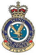 "Military crest for 78 Wing, Royal Australian Air Force, with eagle carrying sword in front of Southern Cross constellation; the motto reads ""Fight"""