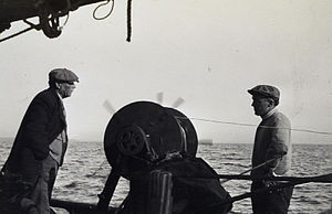 Nicholas H. Heck - Nicholas Heck (right) aboard the contract sloop Nena Rowland during wire-drag survey operations in 1913. It is the only known photograph of Heck in the field.