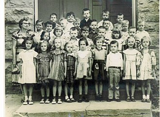 Booneville, Arkansas - First Grade Class standing in front of Booneville Elementary School, former Booneville Co-Educational Institute, 1954.