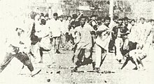 Rioters attacking the Dhakeshwari temple - 1964.jpg