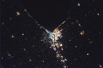 Sarnia - Sarnia from Space, this time at night – Taken by Chris Hadfield, the only astronaut from Sarnia, who wanted to snap a photo of his hometown from the International Space Station. Before the flyover, Hadfield arranged with the citizens of Sarnia via Twitter and Facebook to turn on all their lights both inside and outside their homes.