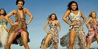 """Missing You (The Saturdays song) - One frame of the video for """"Missing You"""" where The Saturdays are seen in Summer maxi dresses, dancing on the beach in Málaga."""