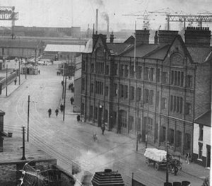Sailortown, Belfast - Whitla Street Fire Brigade station at Sailortown with the docks visible in the background. The firemen and their families lived in houses behind the station.
