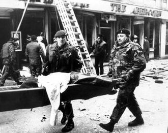 Abercorn Restaurant bombing - A victim's body being removed from the scene by members of the security forces following the bomb explosion