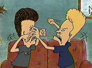 Beavis and Butt-head fighting.