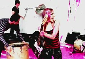 He Wasn't - Lavigne and her band destroy the instruments while pink paint is poured on them by several holes in the studio.
