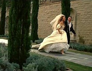 We Belong Together - In the music video, Carey wore her wedding dress from her nuptials to Tommy Mottola in 1993. She is seen running from the altar, alongside her lover (Wentworth Miller), in the video's climactic scene.
