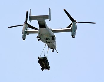 A MV-22 carries a HMMWV