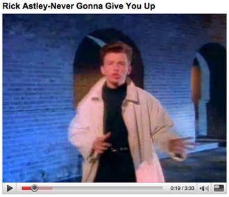 """Rickrolling - A still frame from the music video of the song """"Never Gonna Give You Up"""" by Rick Astley on YouTube, taken in 2008."""