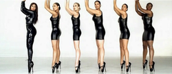 Seven women are formed while they hold her hands up. From left to right, the first woman wears a leather jacket and jeans of the same material, and high heel shoes. All the other women, that are similarly dressed, wear short leather suits and heels.