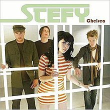 The four members of Stefy stand behind computerized jail bars, with the lead singer, Stefy Rae, standing in the center front.