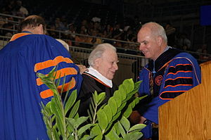 Robert Rietti - Rietti (center) accepting the Honorary Doctorate of the Arts at the University of Florida in 2012