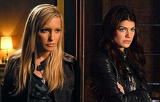 Ruby (Supernatural) - A split image. On the left is the head of shoulders of an attractive blonde woman in her early twenties. On the right is an attractive brunette in her late twenties with her arms crossed.