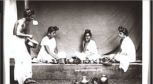 Nair - Nair women having meal in Malabar during the Colonial period