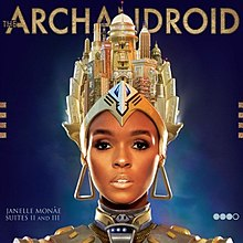 "Image of an African American female shoulders up with headgear consisting of multiple buildings and sculptures whilst wearing large triangular earrings she looks into the camera with robotic style metallic shoulder-wear. The background of the image is blue with it darkening away from her head with the title placed across the top of the cover and her name and the words ""Suites II and III"" of the bottom left hand side whilst four circles three of which are shaded in are placed on the bottom right hand side."